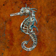 Seahorse handicraft on ground floor - Stock Photo