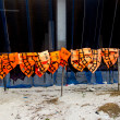 Stock Photo: Life jackets hanging on wood