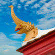 Foto Stock: Phoenix on roof of wooden church