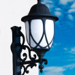 Old lamp on blue sky background — Stock Photo