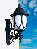 Old lamp on blue sky background — Stok fotoğraf
