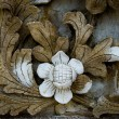 Sculpture of flower on wall — Stock Photo