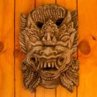 Balinese mask on wood wall — Stock Photo