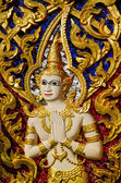Angel status on wall background in the temple.This is traditiona — Stock Photo