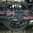 Old steam locomotive wheel and coupling rods - Stock Photo