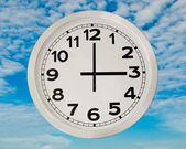 White Clock isolated on blue sky backgroun — 图库照片