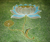 Painting lotus on floor in joss house — Stock Photo