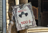 Wooden frame who is wanted — Stock Photo