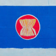 Stock Photo: Painting flag of AEC (ASEAN ECONOMICS COMMUNITY)on wall