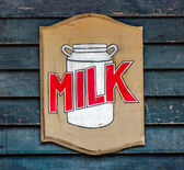 Logo wooden of milk tank — Stock Photo