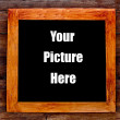 Wooden frame on wood wall — Stock Photo