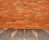 The Perspective view of old wood floor with old brickwall — Stock Photo