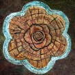 Sculpture ceramic of rose on cement floor — Stock Photo