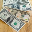 Stock Photo: Closeup Stack of one and ten and one hundred dollar bills