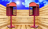 Red telephone box with perspective view on blue sky background — Stock Photo