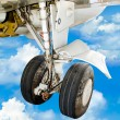 Gear up of plane on blue sky background — Stock Photo