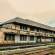 Old building along railway track — Stock Photo