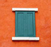 Vintage window on orange wall background — ストック写真