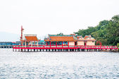 Joss house extend into the sea — Stock Photo