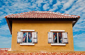 Old fashioned house of Italy style on blue sky background — Stock Photo