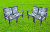 Old wooden bench on lawn — Stock Photo