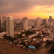 Stock Photo: Sunset in Bangkok city along chao prayriver,Thailand