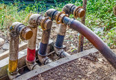 Pipeline with valves in gas station — Stock Photo