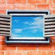 Stock Photo: Old wooden window on brick wall
