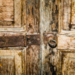 Closeup of old rusty door hinge on wooden door — Stock Photo
