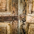 Stock Photo: Closeup of old rusty door hinge on wooden door