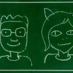 Sketch of boy and girl on blackboard — Stock Photo