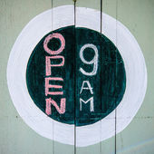 Sketch of sign open 9 am on wood — Stock Photo