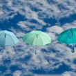Stock Photo: Multicolored umbrellas against blue sky background