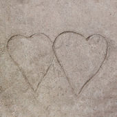Drawing both of heart on cement floor background — Stock Photo