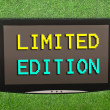 Stock Photo: Lcd screen on artificial green grass of limited edition
