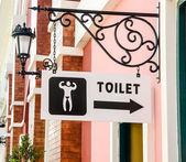 Sign of public restroom for men — Stock Photo