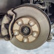 Brake disk and detail of the wheel assembly — Stock Photo