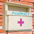 Стоковое фото: Medicine wooden cabinet isolated on wall background