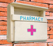 Medicine wooden cabinet isolated on wall background — Stock Photo