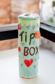 Cylindrical paper of tip box — Stock Photo