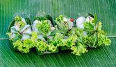 Fresh noodle spring roll on banana leaf background — Stock Photo