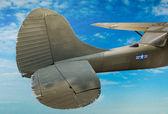 Vintage backside plane of world war on blue sky background  — Stock Photo