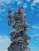 God honor of Guan Yu status isolated on blue sky background — Stock Photo