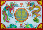 Colorful of dragon and phoenix on wall of joss house  — 图库照片