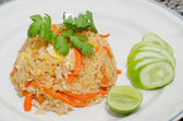 Fried rice with chicken on white plate — Stock Photo