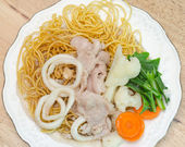 Crispy fried egg noodle with pork and squid and kale soaked in g — Stock Photo