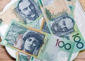 Colorful of Australian Currency on white plate — Stock Photo