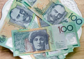 Colorful of Australian Currency on white plate on wood table — Stock Photo