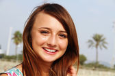 Smiling girl on the beach — Stock Photo