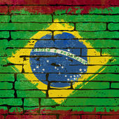 Grunged Brazilian Flag over a brick wall — Stock Vector